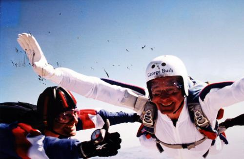 George H.W. Bush Signed & Matted 85th Birthday Skydiving 8x12 Photo BAS #A84998