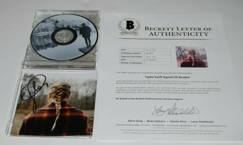 TAYLOR SWIFT signed (EVERMORE) auto CD Cover cd included BECKETT BAS BA84890
