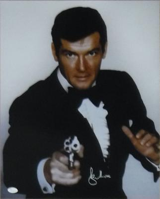 ROGER MOORE AUTOGRAPHED/SIGNED JAMES BOND 16X20 PHOTO 16945 (POINTING GUN) w/JSA
