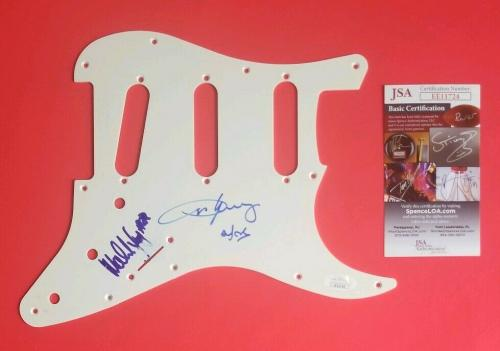 AC/DC - MALCOLM AND ANGUS YOUNG SIGNED STRAT GUITAR PICKGUARD WITH JSA COA psa