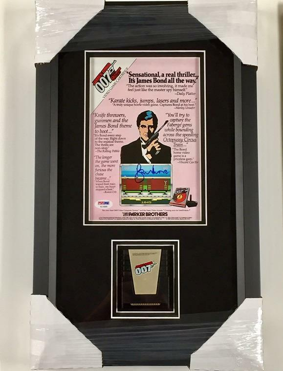 ROGER MOORE Signed James Bond 007 Atari Video Game Ad Photo + Game Cartridge PSA