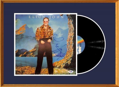 Elton John Autograph Display. Signed Album, Caribou (1974). PSA