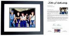 AC/DC Signed - Autographed 11x14 inch Photo BLACK CUSTOM FRAME signed by Angus Young, Malcolm Young, and Phil Rudd - PSA/DNA FULL Letter of Authenticity