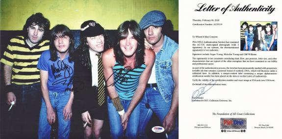 AC/DC Signed - Autographed 11x14 inch Photo signed by Angus Young, Malcolm Young, and Phil Rudd - PSA/DNA FULL Letter of Authenticity