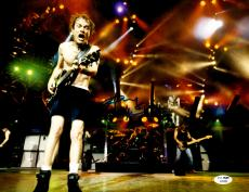 "Angus Young Autographed 11"" x 14""  AC/DC Playing Guitar With No Shirt Horizontal Photograph - JSA COA"