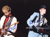 "Annie Lennox & Bobby Hatfield Autographed 8""x 10"" Eurythmics Playing Guitars Photograph - Beckett COA"