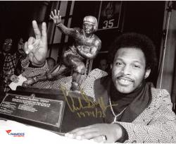 "Archie Griffin Ohio State Buckeyes Autographed 8'' x 10'' Standing with Heisman Trophy Photograph with ""H.T. 1974/75"" Inscription"