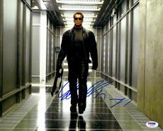 "Arnold Schwarzenegger Autographed 11""x 14"" Terminator 3 :The Rise of The Machines Walking With Gun Photograph - PSA/DNA COA"