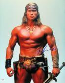 Arnold Schwarzenegger Autographed 16X20 Photo Conan the Barbarian PSA Y48907
