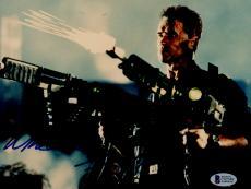 """Arnold Schwarzenegger Autographed 8""""x 10"""" Eraser Shooting Guns Photograph - BAS COA"""