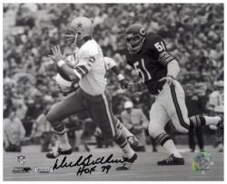 "Dick Butkus Chicago Bears Autographed 8"" x 10"" Chasing Roger Staubach Photograph with HOF 79 Inscription -"