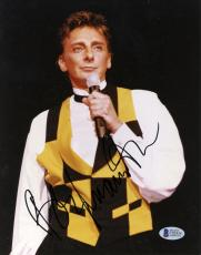 """Barry Manilow Autographed 8""""x 10"""" Singing in Black & Yellow Shirt Photograph - Beckett COA"""