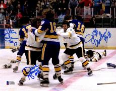 BECKETT-BAS HANSON BROTHERS SLAP SHOT TRIPLE AUTOGRAPHED-SIGNED 8x10 PHOTO 44036
