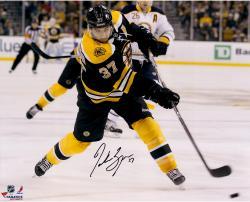 """Patrice Bergeron Boston Bruins Autographed 16"""" x 20"""" Black Uniform Shooting Photograph"""