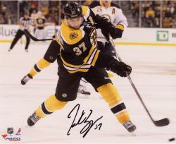"""Patrice Bergeron Boston Bruins Autographed 8"""" x 10"""" Black Uniform Shooting Photograph"""