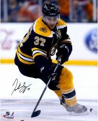 "Patrice Bergeron Boston Bruins Autographed 16"" x 20"" Black Uniform Skating Photograph"