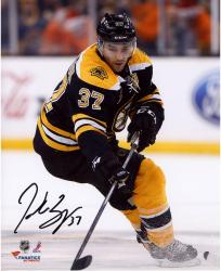 "Patrice Bergeron Boston Bruins Autographed 8"" x 10"" Black Uniform Skating Photograph"