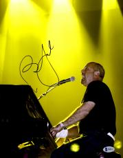 """Billy Joel Autographed 11"""" x 14"""" Playing Piano & Singing Photograph - Beckett COA"""