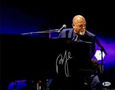 "Billy Joel Autographed 11"" x 14"" Playing the Piano and Looking Into Crowd Purple Background Photograph - Beckett COA"