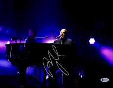 """Billy Joel Autographed 11"""" x 14"""" Playing the Piano and Singing with Purple Background Photograph - Beckett COA"""