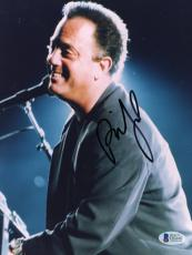 """Billy Joel Autographed 8""""x 10"""" Smiling Sitting at Piano Photograph - Beckett COA"""