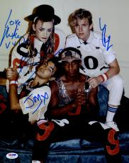 "Boy George, Roy Hay, Mikey Craig, & Jon Moss Autographed 11""x 14"" Culture Club Sitting On Couch Photograph- PSA/DNA LOA"
