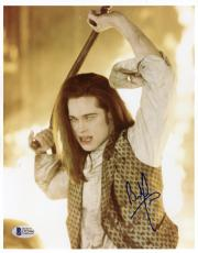 """Brad Pitt Autographed 8""""x 10"""" Interview With The Vampire Holding Cross With Fire Photograph - Beckett COA"""