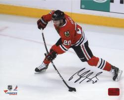 Brandon Saad Chicago Blackhawks Autographed 8'' x 10'' Red Uniform with Puck Photograph - Mounted Memories