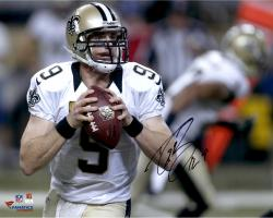 Drew Brees New Orleans Saints Autographed 16'' x 20'' Holding Ball Photograph - Mounted Memories