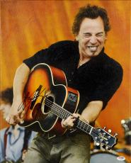 """Bruce Springsteen Autographed Playing Guitar with Orange Background 16"""" x 20"""" Canvas - PSA/DNA LOA"""