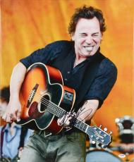 """Bruce Springsteen Autographed Playing Guitar with Orange Background 20"""" x 24"""" Canvas - PSA/DNA LOA"""