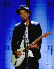 "Bruno Mars Autographed 11"" x 14"" Playing Guitar Photograph - Beckett COA"