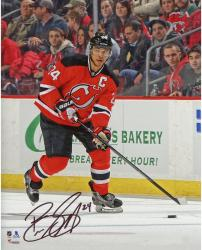 "Bryce Salvador New Jersey Devils Autographed Red Jersey with Puck 8"" x 10"" Photograph"