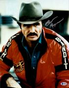 "Burt Reynolds Autographed 11"" x 14"" Smokey And the Bandit- Red Jacket Photograph - Beckett COA"