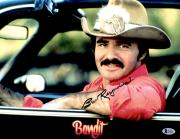 "Burt Reynolds Autographed 11"" x 14"" Smokey And the Bandit- Sitting in Car Photograph - Beckett COA"