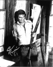 Burt Reynolds Hand Signed Autograph 8x10 Photo Leaning Against Wall W/ Gun