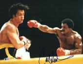 "Carl Weathers Autographed 11"" x 14"" Rocky Punching Photograph - BAS COA"
