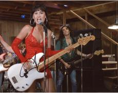 Tia Carrera Autographed 8'' x 10'' Playing Guitar Photograph