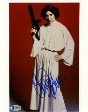 "Carrie Fisher Autographed 8"" x 10"" Star Wars Blaster Gun Photograph Blue Ink - BAS COA"