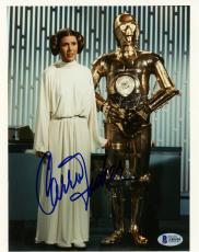 "Carrie Fisher Autographed 8"" x 10"" Star Wars With R2-D2 Photograph - BAS COA"