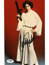 "Carrie Fisher Autographed 8""x 10"" Star Wars Holding Blaster Gun Photograph - PSA/DNA COA"