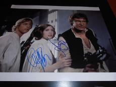 CARRIE FISHER HARRISON FORD SIGNED AUTOGRAPH 11x14 PHOTO STAR WARS HANS SOLO COA