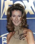 "Celine Dion Autographed 8""x 10"" Fox Sign in Background Photograph - Beckett COA"