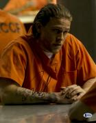 """Charlie Hunnam  Autographed 11"""" x 14"""" Wearing Orange Jump Suit Sons Of Anarchy Photograph - Beckett COA"""