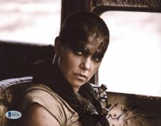 "Charlize Theron Autographed 8"" x 10"" Mad Max Face Close Up Photograph - Beckett COA"