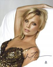 """Charlize Theron Autographed 8"""" x 10"""" Posing Photograph - Beckett COA"""