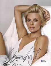 "Charlize Theron Autographed 8"" x 10"" Posing with White Dress Photograph - Beckett COA"