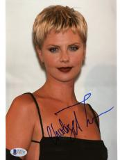 "Charlize Theron Autographed 8""x 10"" Wearing Black Dress Photograph - Beckett COA"