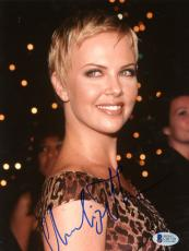 "Charlize Theron Autographed 8""x 10"" Wearing Leopard Dress Photograph - Beckett COA"