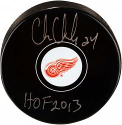 Chris Chelios Detroit Red Wings Autographed Logo Puck with HOF 13 Inscription - Mounted Memories